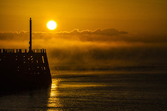 rolling in 1 (photoautomotive) Tags: newhaven eastsussex england europe englishchannel pier port harbour sky sunrise water waves ripples sea sussex mist fog sun canon 7d 35350l
