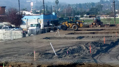 (Rich T. Par) Tags: pomona phillipsranch socal southerncalifornia losangelescounty lacounty constructionsite california palmtrees tree suburb dirt civilengineering sky parkinglot frontloader civilengineers tubes pipes heavyequipment