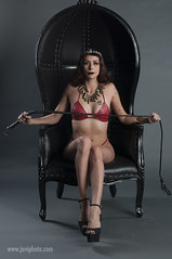 mynx402a (javiphoto.com) Tags: mynxx brunette red leather fetish highheels whip laether chair crown piercings bullets tattoos