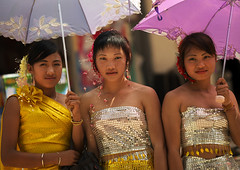 Young Women In Traditional Clothes Holding Umbrellas, Menglun, Yunnan Province, China (Eric Lafforgue) Tags: 3people a7100 asia bright china chineseculture chineseethnicity colorpicture costume day females frontview holding horizontal lookingatcamera outdoors parasol realpeople shy teenager threepeople threepersons travel waistup women xishuangbanna yunnan yunnanprovince menglun