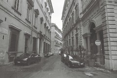 Roma (Streak B&W) (goodfella2459) Tags: nikonf4 afnikkor24mmf28dlens revologstreakblackandwhite 35mm blackandwhite film analog roma city streets buildings cars italy rome bwfp