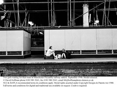 """YZ12/26 (hoffman) Tags: baggage building construction females horizontal lady luggage passengers platform renovation scaffolding suitcases travellers woman 181112patchingsetforimagerights manchester uk davidhoffman davidhoffmanphotolibrary socialissues reportage stockphotos""""stock photostock photography"""" stockphotographs""""documentarywwwhoffmanphotoscom copyright"""