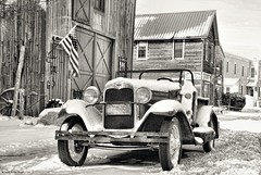 Old-timey.... (Joe Hengel) Tags: oldtimey preservationforge lowerslowerdelaware lsd lewesde lewes sussexcounty car oldcar convertible snow snowy winter street building historic historicbuilding delaware de flag blackandwhite bw monochrome