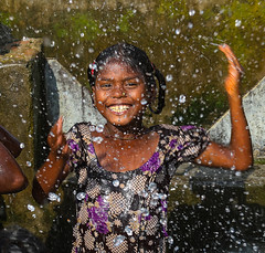 Diamonds are forever; and smiles?... (ybiberman) Tags: varanasi india utterpradesh children girl people streetphotography candid pool irrigationpool nosering fun joy happiness smiles waterdrops