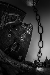 Keeps everything in one place (Soren Wolf) Tags: black white bw architecture street cracow kraków poland streets people pedestrian pedestrians sky dramatic chain church fisheye wide nikon d7200 samyang 8mm