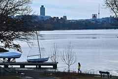 Walking by the River (AntyDiluvian) Tags: boston massachusetts river charlesriver communityboating girl walking dock sailboat esplanade