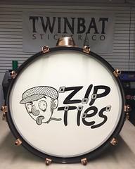 Zip Ties bass drum head (Tom Bagley) Tags: albertacanada calgary tombagley punk cartoon twinbatstickerco zipties