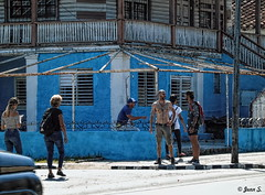 Opposite side of the street (Jean S..) Tags: candid streetphotography men women varadero house stairs windows blue hairy street passerby