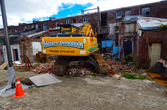Do Not Upset Your Builders (Steve Taylor (Photography)) Tags: angry eyes southerndemolition streetart graffiti building demolition door brown orange yellow white weird strange brick newzealand nz southisland canterbury christchurch cbd city perspective excavator digger heavymachinery
