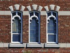 Three church windows, Trinity-Bellwoods, Toronto (edk7) Tags: nikond300 edk7 2009 canada ontario toronto church architecture building oldstructure window gothicrevival brick glass symmetry city cityscape urban
