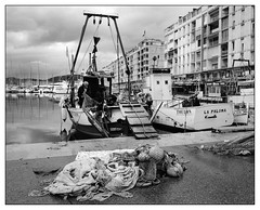Mending the nets (Wilco1954) Tags: france fishingboat var fisherman rainymorning nets toulonharbour