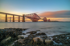 Forth Bridge, South Queensferry (MilesGrayPhotography (AnimalsBeforeHumans)) Tags: 2470 fe2470mmf4zaoss sonyfe2470f4zaoss architecture autumn a7rii sonya7rii britain bridge railbridge forthrailbridge beach dusk europe evening fe f4 firthofforth fife glow historic iconic forthbridge forthbridges landscape lens longexposure landscapephotography engineering nd nd1000 10stopper outdoors old oss ocean photography photo rocks scotland scenic sunset sony ilce7rm2 sonyilce7rm2 scottish scottishlandscapephotography sea seascape southqueensferry town uk unitedkingdom unesco village waterscape wide zeiss