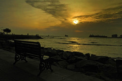 """""""Never waste any amount of time doing anything important when there is a sunset outside that you should be sitting under!"""" -  C. Joybell C. (Abeer!) Tags: abeer abeerbarman bench beach ship clouds dusk dark fortkochi arabiansea india kochi kerala landscape nature path sky scenery sunset shore sunlight sea water waterscape waves yellow rock tree trees"""