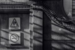 Mind the Wall (Revisited) (JeffStewartPhotos) Tags: wall shadows signs warnings mindthegap nosmoking subway subwaystation lawrencewest lawrencewestsubwaystation ttc torontotransitcommission jsp201811104 blackandwhite blackwhite bw toned walkingwithpaulc