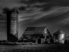 Flag Barn (Tim @ Photovisions) Tags: nikon barn nebraska farm coolpix gagecounty farmstead silo usa roof paint america blackandwhite monochrome