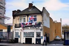 'Royal Charlie' pub, Chrisp Street, Poplar, Tower Hamlets, London E14. (edk7) Tags: nikond610 nikonafnikkor28105mm13545d edk7 2015 uk england london londone14 londoneastend londonboroughoftowerhamlets poplar 116chrispstreet localworkingclasspub royalcharlie architecture building oldstructure sign signage word flag ka car sidewalk sky cloud chimney tvantenna
