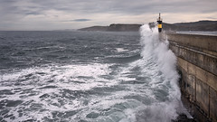 Faro de Comillas (Alberto Lacasa) Tags: comillas cantabria puerto faro harbour port lighthouse olas waves mar oceano ocean sea clouds nubes sky cielo landscape paisaje seascape nature wind viento oleaje fury strong fuerza dramatic coast costa cliffs muro wall