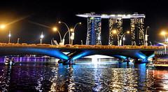Marina Bay at Night, Singapore. (Manoo Mistry) Tags: singapore marinabay nikon nikond5500 tamron tamron18270mmzoomlens holiday tourism tourist nightscene night nightscape water reflection marinabaysand bridge