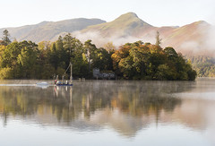 Morning Commute (Tracey Whitefoot) Tags: 2018 tracey whitefoot autumn fall cumbria lake district lakes derwent water derwentwater mist misty morning boat tow commute reflection reflections reflected catbells isle island house boathouse keswick national park