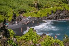 Honokalani Black Sand Beach (Susan.Johnston) Tags: roadtohana waianapanapastatepark maui hawaii blacksandbeach volcanicrock swimmers volcaniccoastline cove