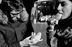 Yum. (Baz 120) Tags: candid candidstreet candidportrait city contrast street streetphotography streetphoto streetcandid streetportrait strangers rome roma ricohgrii europe women monochrome monotone mono noiretblanc bw blackandwhite urban life portrait people italy italia grittystreetphotography faces decisivemoment