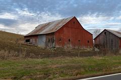 Brittingham Barn — Sprigg Township, Adams County, Ohio (Pythaglio) Tags: brittingham farm agriculture buildings structures historic barns ohio unitedstates us barn bentonville adamscounty spriggtownship verticalboard red painted metal roof sky clouds
