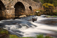 Postbridge (Christian Hacker) Tags: postbridge stonebridge historic architecture longexposure watermovement cokinfilter nd8 gorse yellowflowers stream roadbridge dartmoor nationalpark devon riverdart grass gradeiilisted canoneos50d tamron1750mm uk landscape