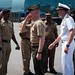 U.S. military leaders salute members of the Indian Navy as the USS Rushmore arrives in Chennai, India