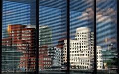 Gehry in the window (Logris) Tags: gehry buildings gebäude häuser window fenster architecture architektur düsseldorf dusseldorf medienhafen media harbor