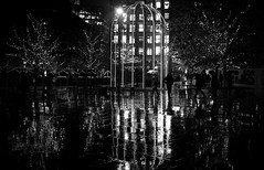 Rain And The Birdcage (rwbthatisme) Tags: kings cross station rain street birdcage monochrome fujufilm x100f london reflection puddles