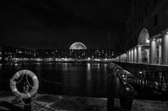 Albert docks with boat (douglasjarvis995) Tags: wheel lights monochrome mono dark sea water liverpool docks night ricoh grii
