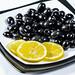 Black marinated olives with lemon slices