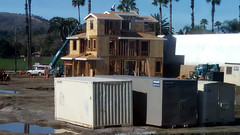 (Rich T. Par) Tags: pomona phillipsranch socal southerncalifornia losangelescounty lacounty constructionsite california palmtrees tree road suburb dirt civilengineering tractor brickwall heavyequipment storagebin cargocontainer lumber house forklift crane sky plywood constructionvehicles puddle civilengineers architecture