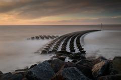 Cobbolds Point (selvagedavid38) Tags: suffolk coast shore sea waves beach defences breakers groyne rocks felixstowe long exposure cobboldspoint tide shingle tripod sunrise dawn golden hour seascape northsea