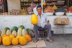 Osh, Kyrgyzstan (dan smo) Tags: fruit fresh melons colour shopkeeper bazaar market centralasia