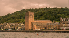 St. Columba's Cathedral, Oban, Scotland. (Alex-de-Haas) Tags: argyllandbute aurorahdr aurorahdr2019 blackstone d850 gb greatbritain hdr irix irix11mm irixblackstone lightroom nikon nikond850 oban obanbay schotland scotland skylum stcolumbascathedral uk unitedkingdom baai bay cathedraal cathedral catholic church cloud clouds faith geloof harbor harbour haven highlands holidays hooglanden journey katholiek kerk landscape landschaft landschap lucht port reis reizen religie religion roadtrip sea skies sky summer travel travelling vacation water wolk wolken worship zee zomer