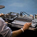Audio technician working on a mixer console