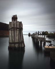 Founder's Landing (tylerjacobs) Tags: sony a6000 sigma 16mm f14 long exposure expo marquette michigan dock water pier abandoned dilapidated decay ruin ruined cold fall blue lake superior