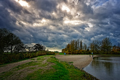 Walking The Dog (Alfred Grupstra) Tags: nature tree water sky outdoors cloudsky river scenics landscape lake autumn reflection blue forest greencolor beautyinnature cloudscape tranquilscene travel grass