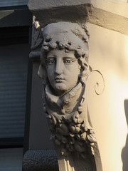 Woman with High Collar Gargoyle Next to Door Way 4849 (Brechtbug) Tags: woman with high collar gargoyle next door way front exterior building entrance new york city near 9th ave west 21st street nyc 2018 gargoyles statue sculpture man portrait art downtown stone terracotta tile artist portraits 20s area w women slope low nose november 11122018