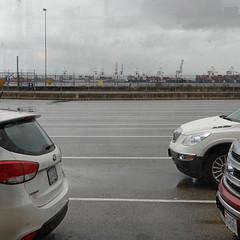 BC Ferries, Tsawwassen, looking towards Roberts Bank super port (pjwoodland) Tags: ferry rain pointroberts tsawwassenferryterminal pavement cars clouds