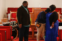 A'Nasia Monford spends time with her parents, Rodricus and Amy Monford, after a service at Hills Chapel Baptist Church.