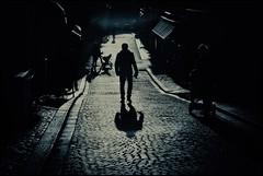 Stockholm Noir (*Kicki*) Tags: stockholm gamlastan sweden oldtown fotofikapromenad autumn man person people silhouette street candid pram backlight shadow backlit noir