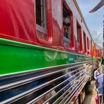 Close encounter with the train at Hoop Rom Market near Mae Klong railway station in Samut Songkhram province, Thailand thumbnail