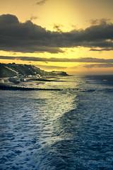 View from the Pier (John Joslin) Tags: cromer norfolk england sea saescape ocean sky sun sunset waves surf clouds rain golden town seaside coast beach winter