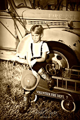 timeless.....Our Gang.. (glasskunstler) Tags: boy youth 1930s wagon firefighter sepia photoshoot aged firetruck sony zeiss 55mm18 play pretend