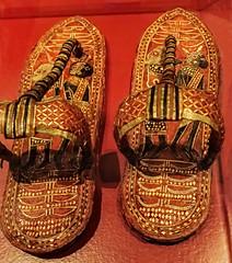 A pair of King Tut's ornate ceremonial sandals depicting captured Nubian and Asian prisoners 18th dynasty New Kingdom Egypt (mharrsch) Tags: kingtut tutankhamun artifact treasure exhibit tomb egypt 18dynasty newkingdom discoveryofkingtut omsi oregonmuseumofscienceandindustry portland oregon mharrsch