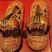 A pair of King Tut's ornate ceremonial sandals depicting captured Nubian and Asian prisoners 18th dynasty New Kingdom Egypt