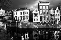 The Old Lock (YIP2) Tags: street fence city urban lines canal water surreal simple less linea detail geometry pattern details strtet roas lock urbandetail texture surface outside shadow bridge bw monochrome blackandwhite schiedam architecture white reflection building houses