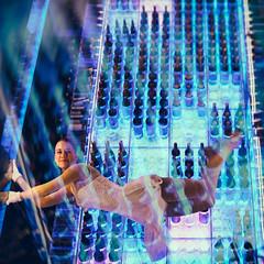 Wine Angel . (helmet13) Tags: leicaxvario studies people woman acrobat acrobatic wineangels winetowerbar radissonbluzurichairport smile floating bottles performance champagne wine aoi peaceaward world100f